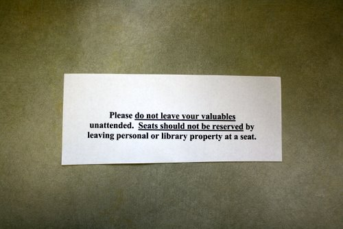 Library warning slip: Please do not leave your valuables unattended. Seats should not be reserved by leaving personal or library property at a seat.