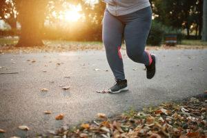 Female runner running in the park