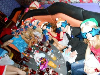 Group sat around table with drinks and star glasses.