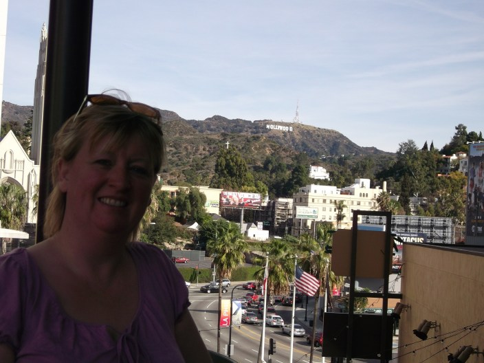 Susan in front of the Hollywood sign.