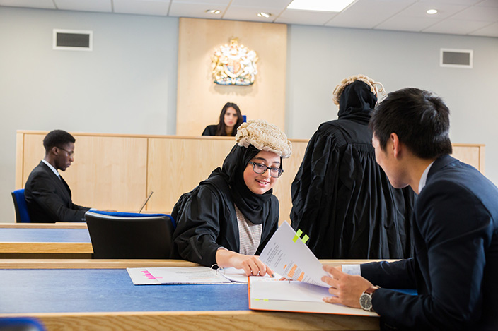 A group of students using the University's Lady Hale mock courtroom.