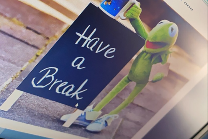 A laptop screen displaying the text 'Have a Break'.