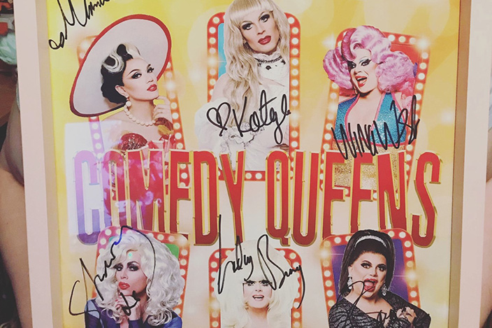 Aimee's signed photo with pictures and autographs from six drag queens.