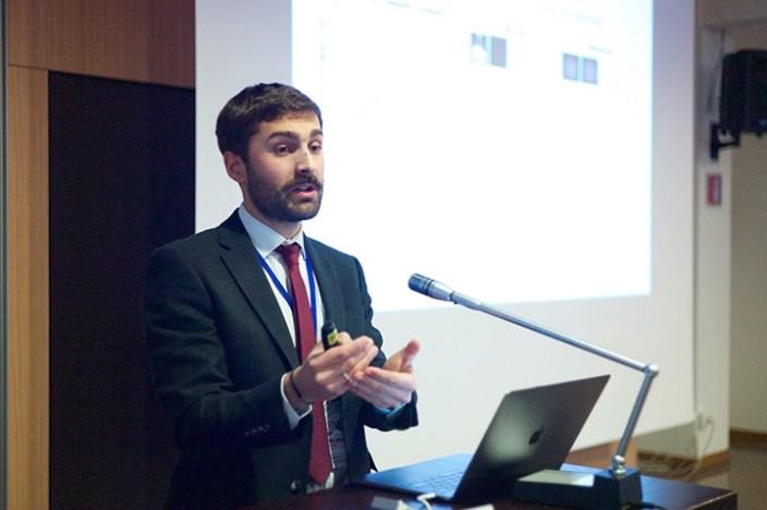 Riccardo presenting a lecture.