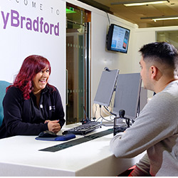 A student speaking to a member of the MyBradford support team.