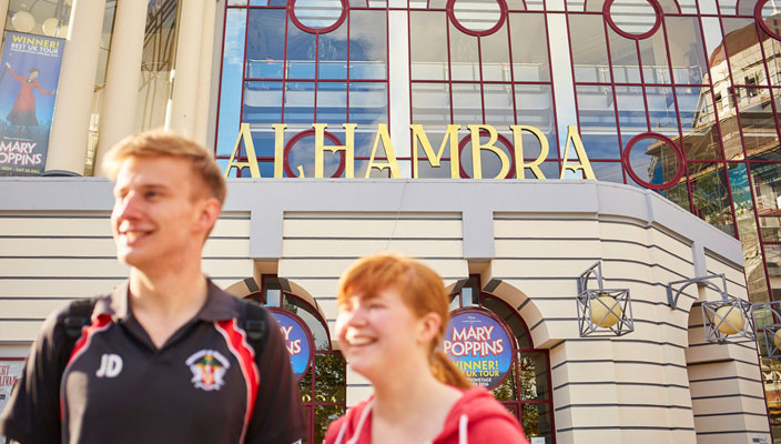 Students in front of the Alhambra Theatre, Bradford