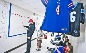 Clay Jackson/cjackson@amnews.com Jordan Gay checks out a graph that the students created that charted the length of his kicks Tuesday at Bate Middle School.