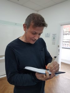 Ben signing a copy of his book for EJRU member and