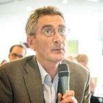 Cardiff EDC Director Ian Thomson speaking into a microphone