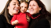 Little girl with mother and grandmother - image credit: iStock