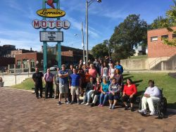 27 people gather near marquee for the Lorraine Motel