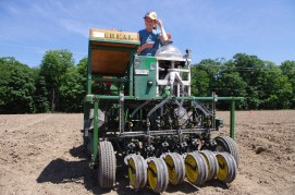 Ann with cone seeder, planting plots at the Musgrave Research Farm.