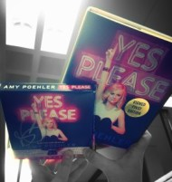 Hands holding up copies of aYes Please by Amy Poehler book and audiobook
