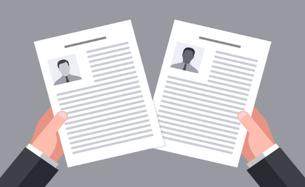 cartoon of hands holding resumes with outlines of men's photos on them. black and white