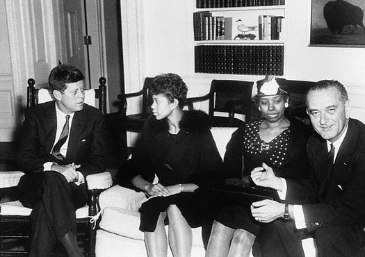 President Kennedy talking with Olympic Gold Medalist Wilma Rudolph, her mother, and Vice President Lyndon Johnson, April 14, 1961.