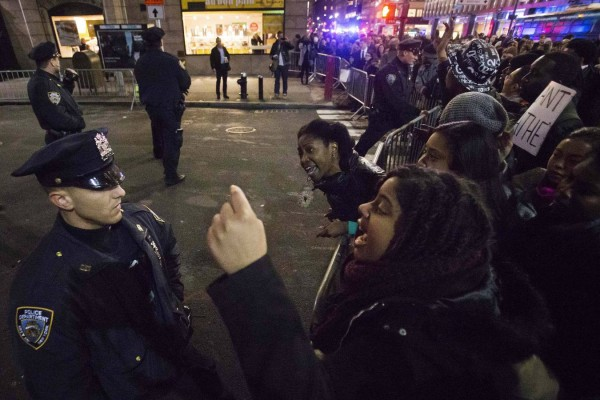 Protesters, demanding justice for the death of Eric Garner, shout at police at a roadblock in Midtown Manhattan, New York