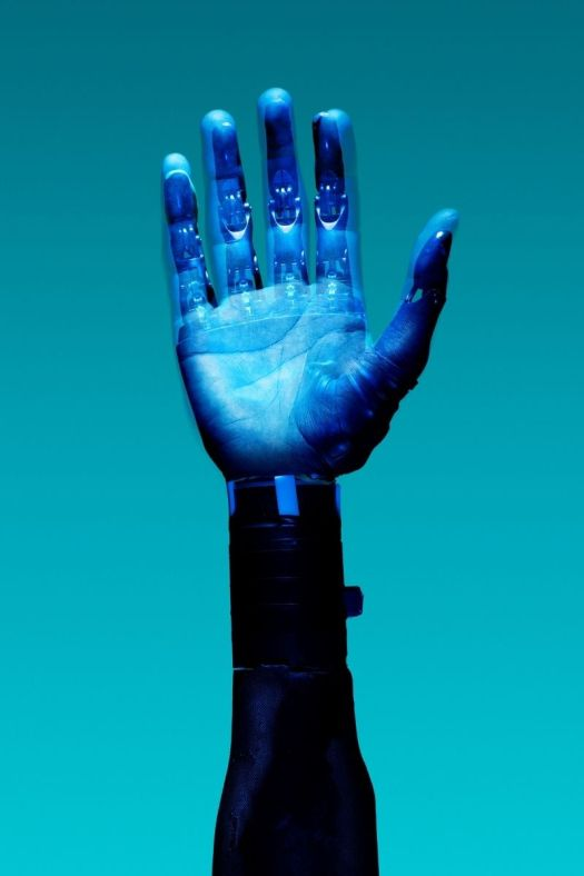 A robotic hand can be seen.