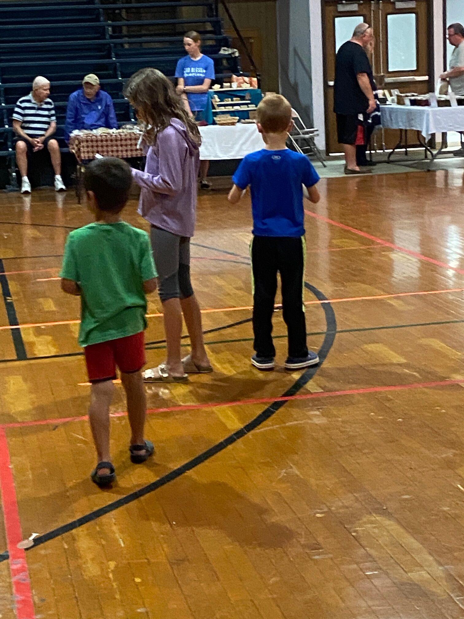 kids deciding which vendor to go to next