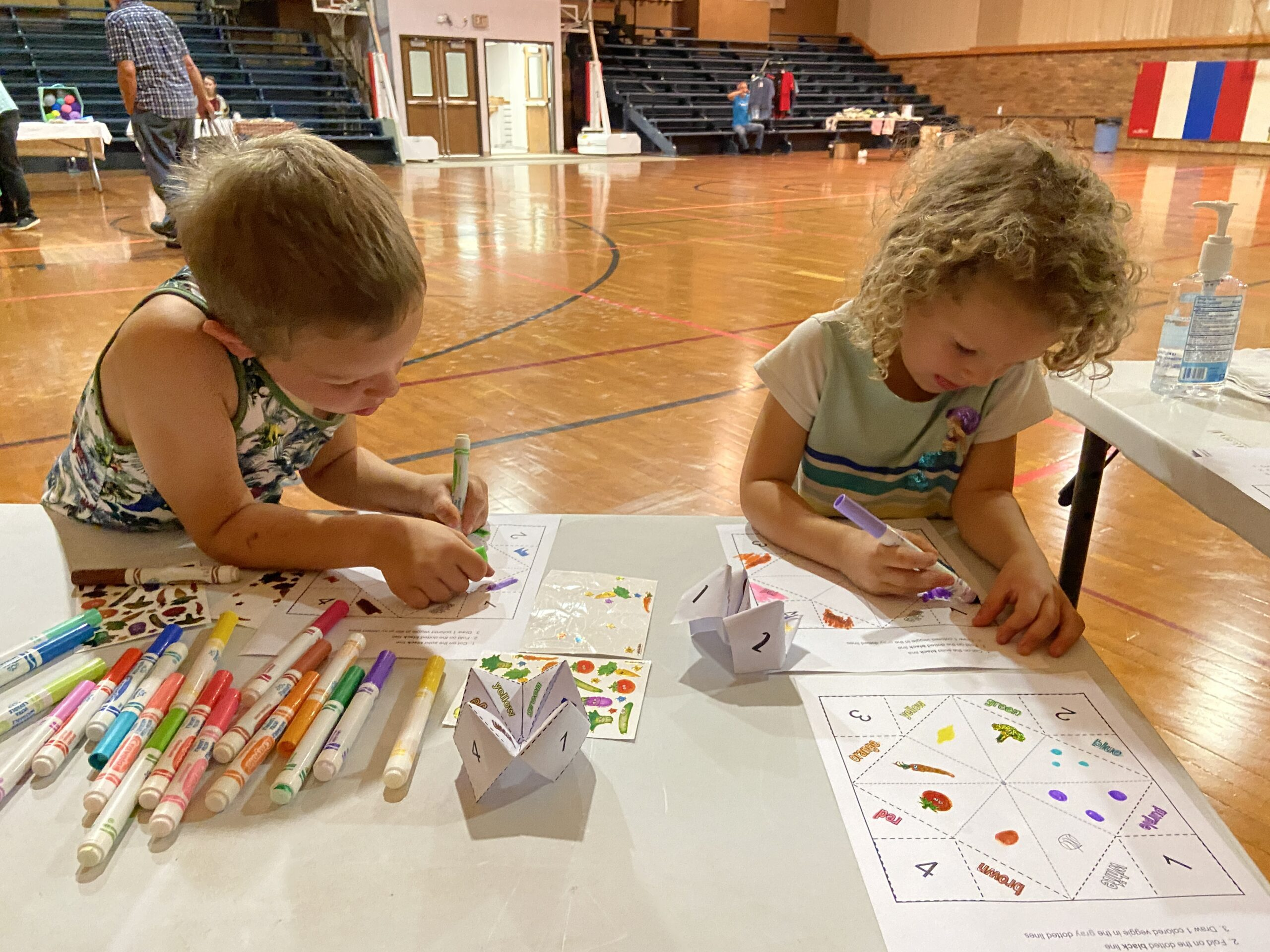 Kids coloring their fortune tellers