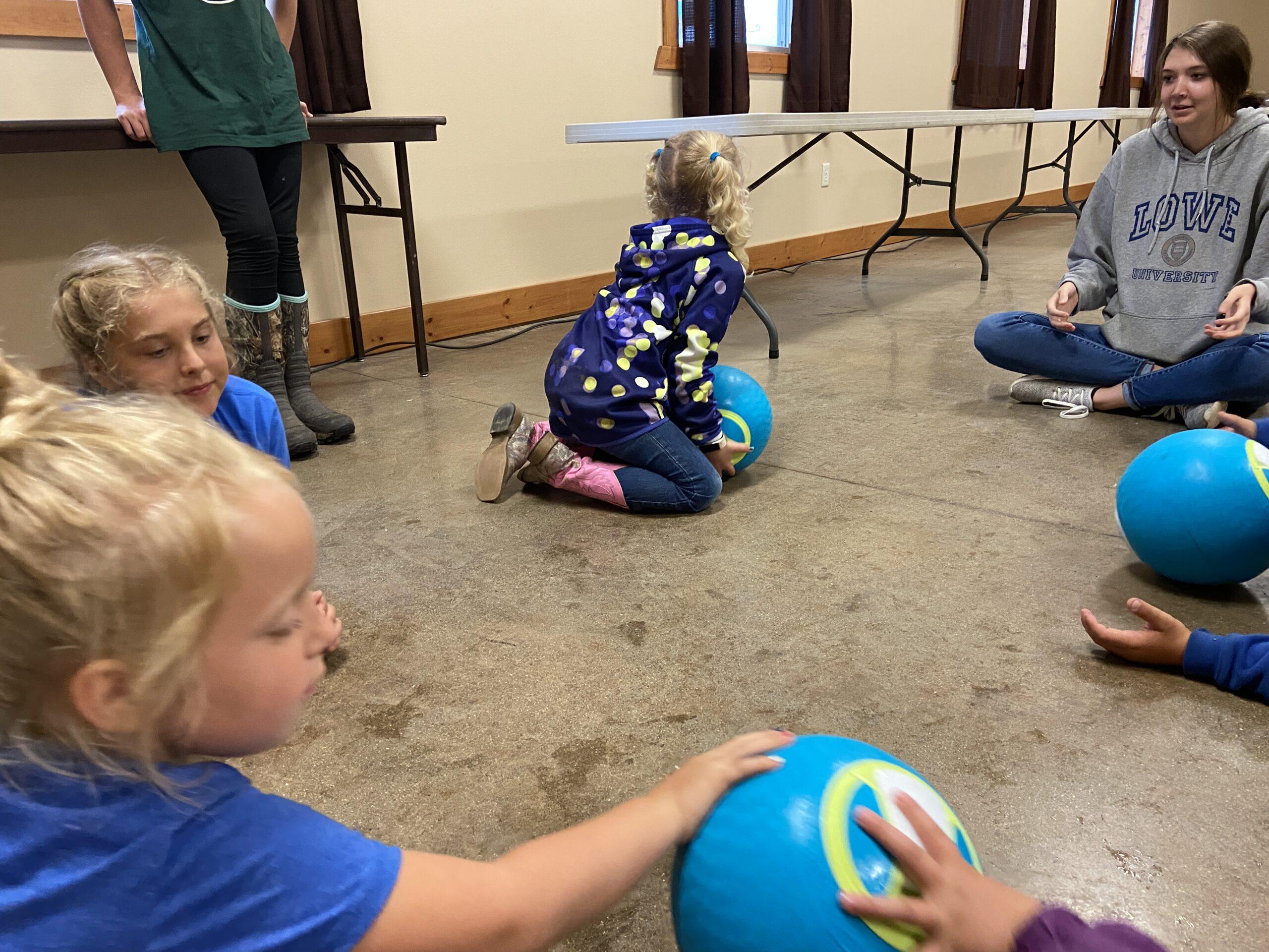 Kids rolling a ball to make ice cream