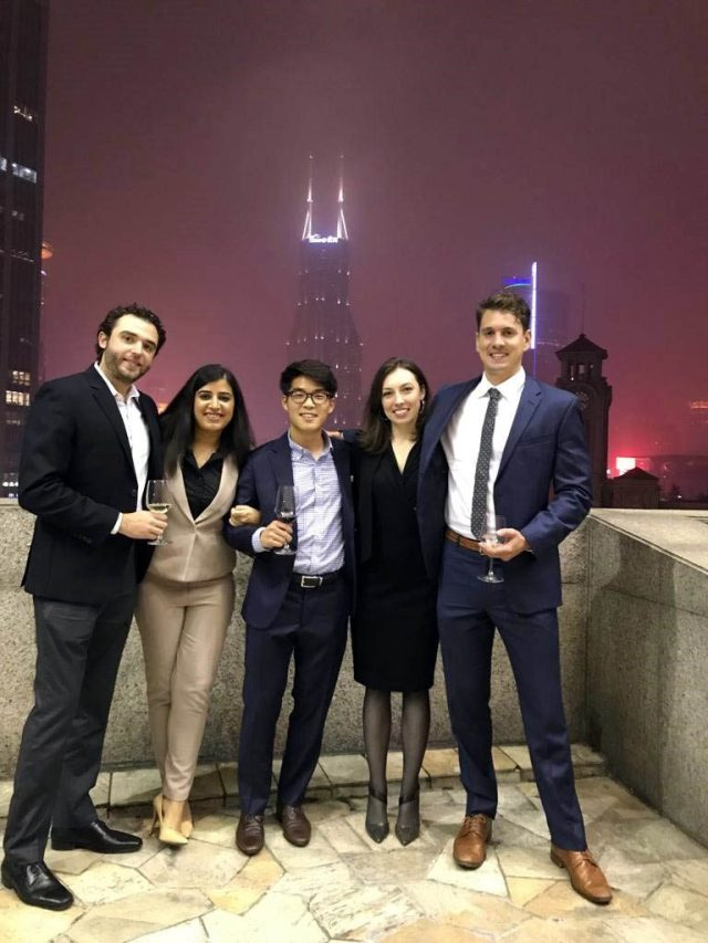 five students pose for a rooftop photo with Shanghai's skyline in the background; key learnings