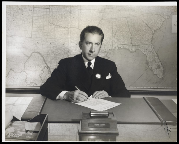 Portrait of J. Paul Getty at his desk