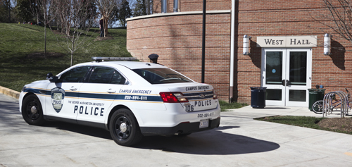 Multiple police cars were parked outside West Hall on Tuesday afternoon. Cameron Lancaster | Assistant Photo Editor
