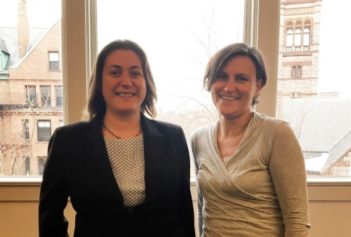Image of our new case writers, Brittany Deitch, left, and Rachel Gordon, right, in front of large office window