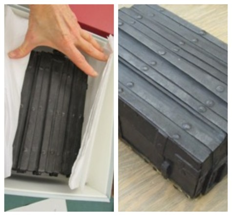 Two views of an iron-reinforced wooden chest that contains a fifteenth-century French coffret.