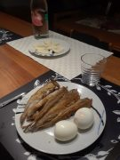 Boiled eggs, fried fish, and cheese slices