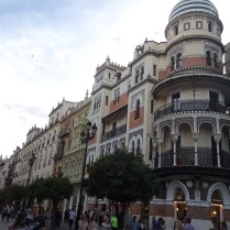 A look at the detailed buildings of Seville's Avenida de la Constitucion.