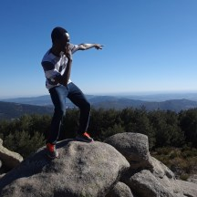 Comically posing on a mountain overlooking Cercedilla, a town outside of Madrid.
