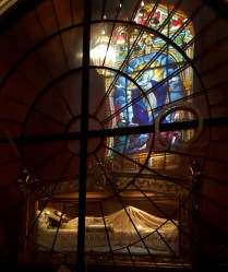 Many churches in Spanish-colonized countries have displays like these, of a bloodied Christ in a glass coffin. This one was built directly across from a stained glass depiction of Mary. Her image is eternally reflected over her son.