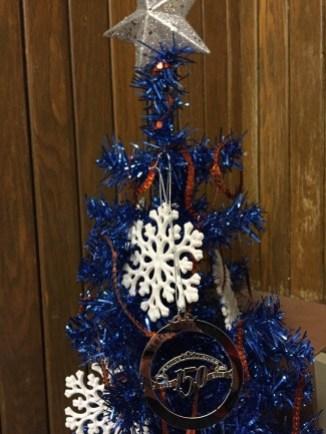 Little blue Christmas tree with Hope keepsake ornament on it