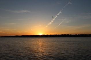 sun setting over Lake Macatawa