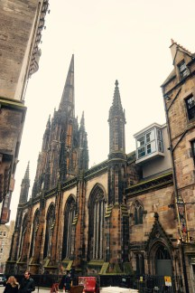 Many of the buildings were made with stone that was absorbent. Scotland used to be a very smoky city, and so the stones absorbed the smoke, giving them a darker color and a more Gothic feel.