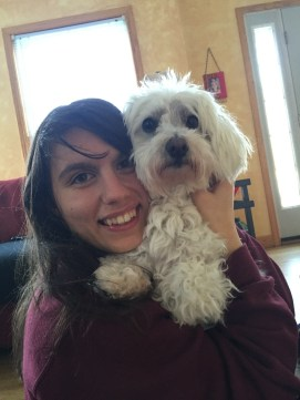 Ashley holding her little white dog, Kalvin