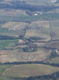 Peace sign mowed in farm field