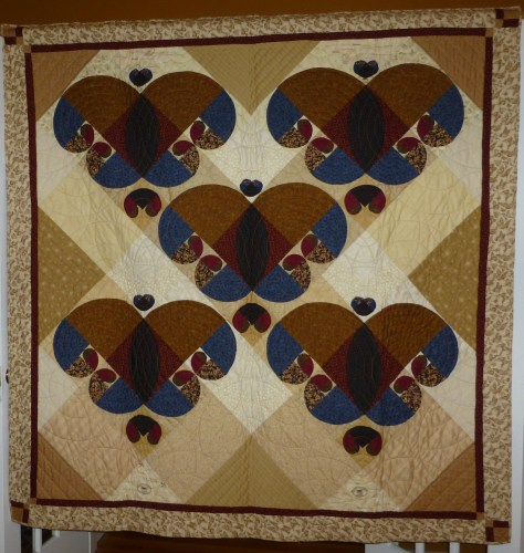 """Leonardo's Garden,"" the first in my Fibonacci series.  I learned a lot on this quilt, which does not bear close inspection.  The background is from the 2004 Moda Challenge, but the qult wasn't finished until 2005."