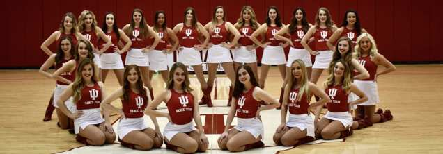 dance team formally posed in a gymnasium