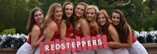 7 dance team members holding Redstepper sign