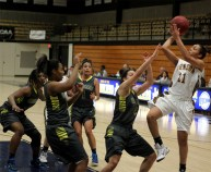 Erica Nelson hitting a step back against a host of Scottie defenders against Highland Community College. The Cavs were victorious in the game 75-56.