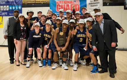 The team poses with their national championship hats after the final game victory against Parkland. The Cavs won 46-44. Photo by Mike Abell