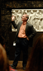 Michael Robertson addresses a gathering of students as he talks about an art piece on display at the Nelson Atkins Muesum.Photo courtesy of the college