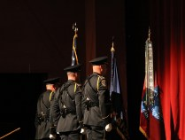 The Honor Guard stands in formation after presenting the colors. Photo by Lance Martin