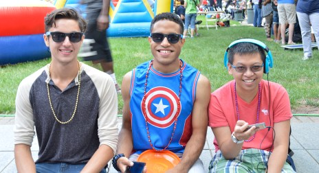 Jon Pedroza (Student & Glee Club Member), Vincent Duncan ( Student & Member of LGBT & Glee), Ivan Beltran (Student) socializing and enjoying free food. Photo by E.J. Wood.