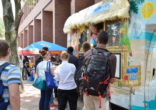 Eric Murtz, Kona Ice operator, passing out free snow cones to students and faculty. Photo by E.J. Wood.