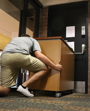 L - Lockdown or shelter in place by locking down and barricading entry points. Get low to the floor, spread out and turn off lights. Photo by Lance Martin