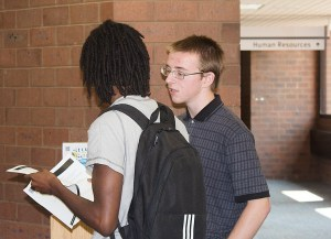 Student Senate president John Rives gives information to an interested student.