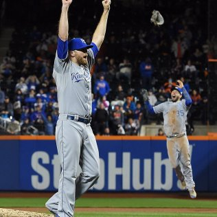 Kansas City Royals relief pitcher Wade Davis, left, and first baseman Eric Hosmer react after finishing off the New York Mets in the 12th inning to win the World Series on Sunday, Nov. 1, 2015, at Citi Field in New York. Photo courtesy of Kansas City Star, John Sleezer jsleezer@kcstar.com